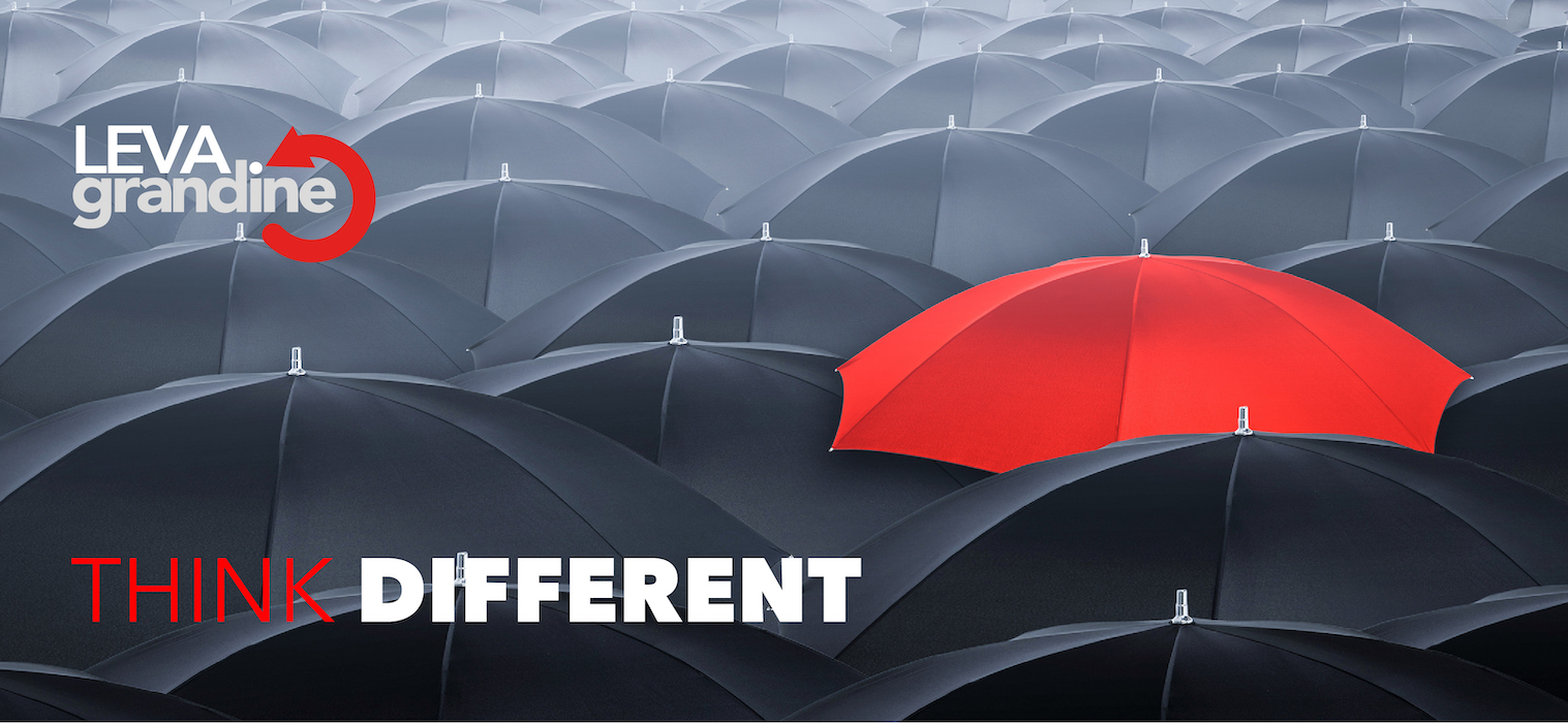 Different and standing out of the crowd umbrella. Concept of leader.
